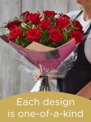 Valentine's 12 red rose hand-tied bouquet made with premium roses